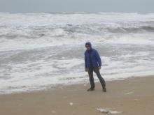 Barrett leaning into 40 - 55 mph wind on the ocean beach
