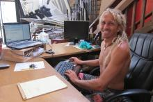 Office work Maui style, Pascal managing finances at Board Shop