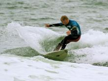 Surfer showing winning moves