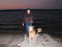 """Diane arrives too late to sail, but enjoys a sunset over the water with """"Puppy."""""""