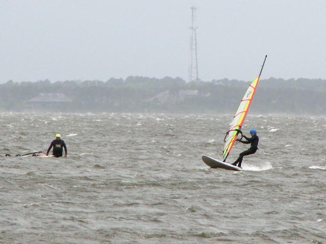 Adam on a 3.4 meter sail