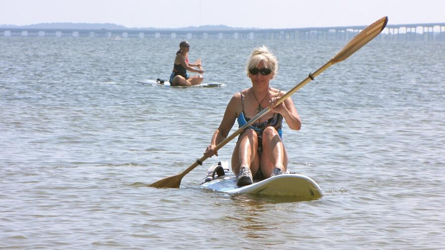 IMG_3159 Peggy & Betsey paddling boards on no-wind day.jpg