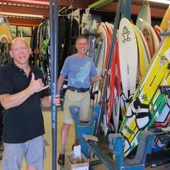 Kevin renting gear to Barrett at Hawiian Is. Surf & Sport